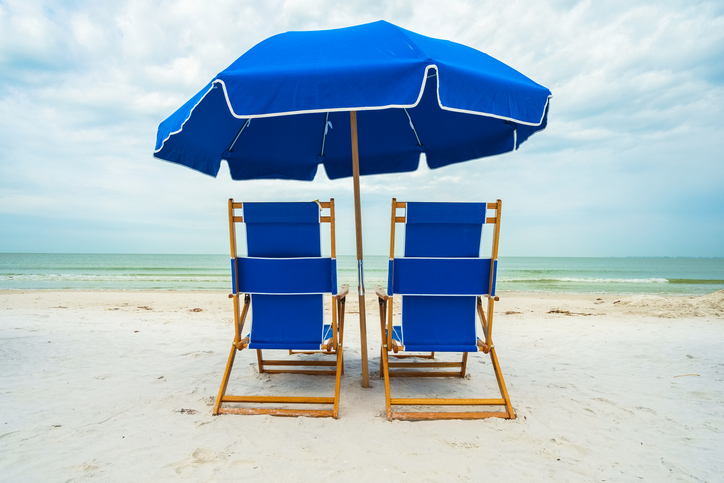 Chairs sit on a beach